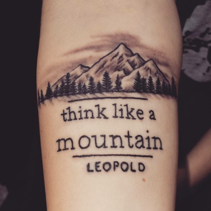 think like a mountain, quote by leopold, written underneath mountain range with trees, mountain tattoo meaning