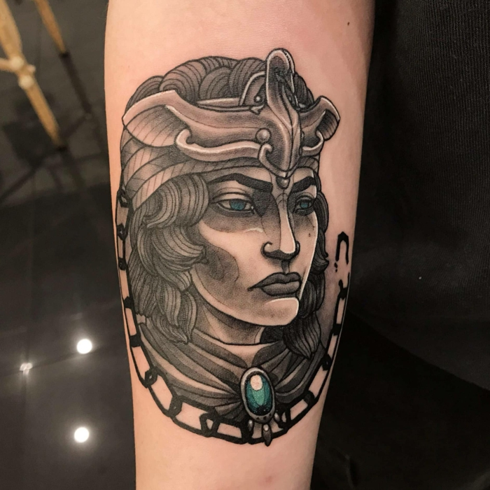 empress queen zenobia, black and grey tattoo wtih blue eyes and blue rhinestone, traditional style tattoos