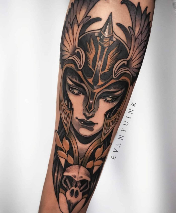 traditional style tattoos, woman warrior, female face with a large helmet with wings, forearm tattoo