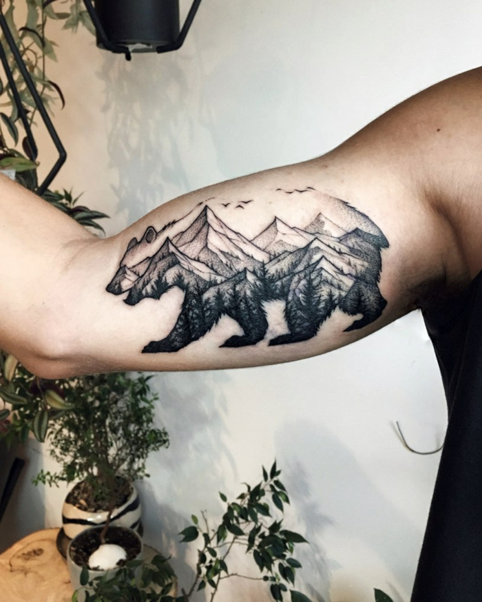 mountain range tattoo, inside the outlines of a bear, inside the arm tattoo, white background