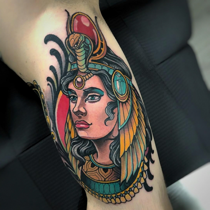 woman from egyptian times, crown on her head with a cobra and red ruby, neo traditional tattoo designs