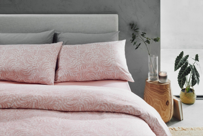 light pink cotton bed sheets, spread on king size bed, anniversary gifts by year, wooden bed side table on the side
