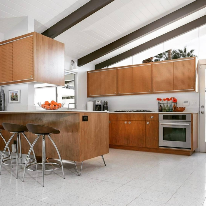 mid century modern kitchen, wooden cabinets with white countertops, white tiles on the floor