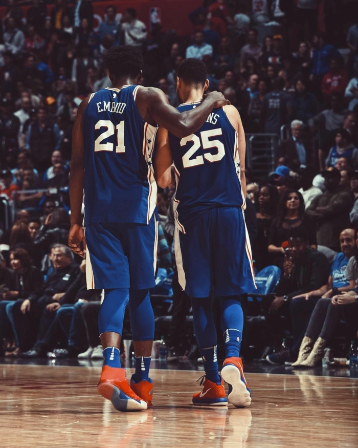joel embiid and ben simmons, basketball backgrounds, wearing philadelphia 76ers uniforms, standing on the court