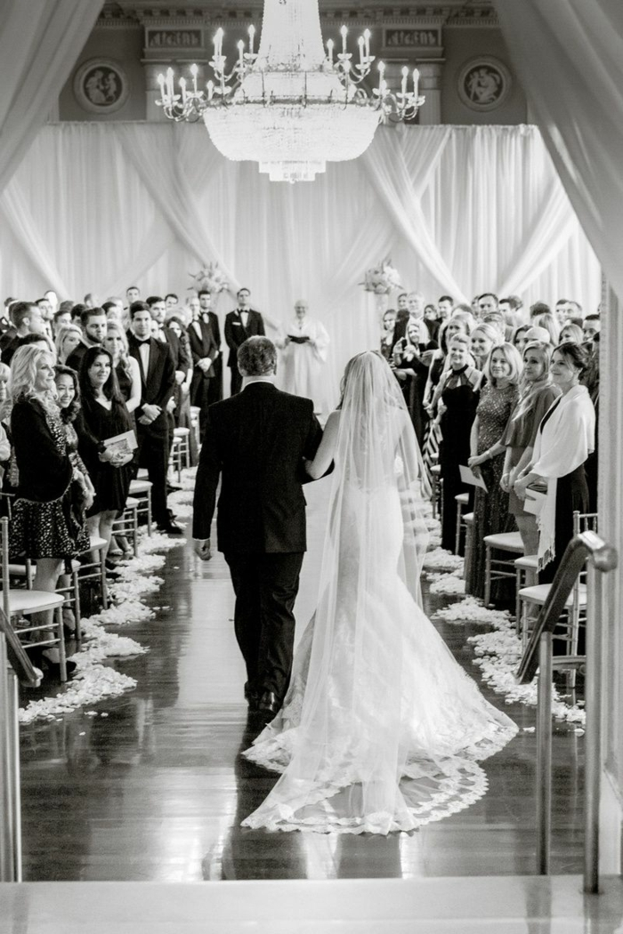 black and white photo, songs to walk down the aisle to, bride being walked down the aisle by her father