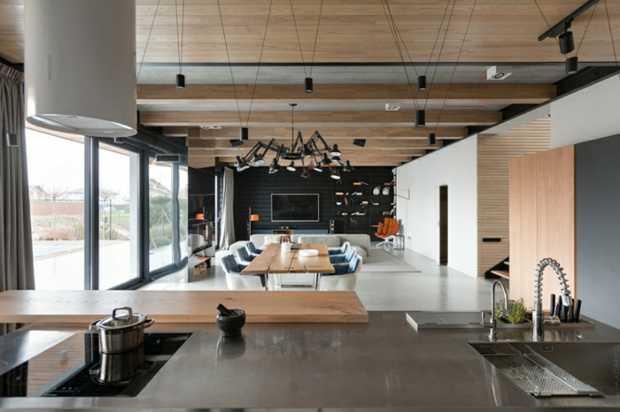 open plan space with kitchen, dining room and living room, modern living room ideas, black accent wall