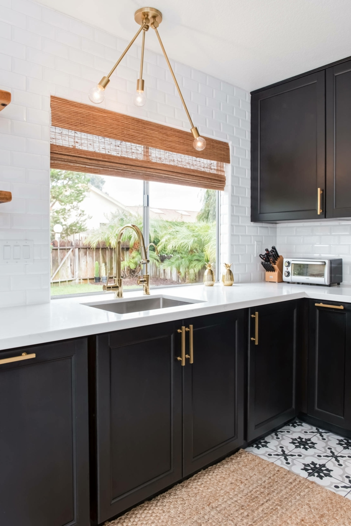 black cabinets with white countertops, contemporary kitchen cabinets, white subway tiles backsplash