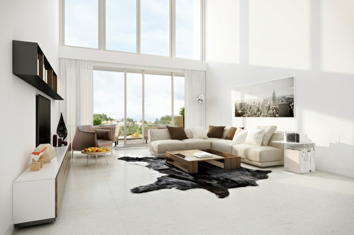 white walls, white corner sofa, white floor with black rug, how to decorate your living room