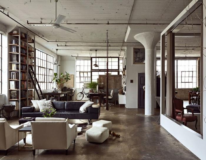 industrial apartment, black leather sofa, white armchairs, luxury living room furniture, granite floor, large bookshelf