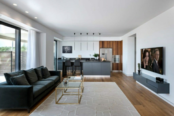 black sofa, glass coffee table, wooden floor with white carpet, how to decorate a living room, kitchen island