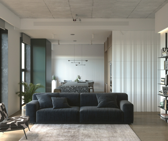 black sofa, wooden floor with white carpet, contemporary living room, open plan space with kitchen and living room
