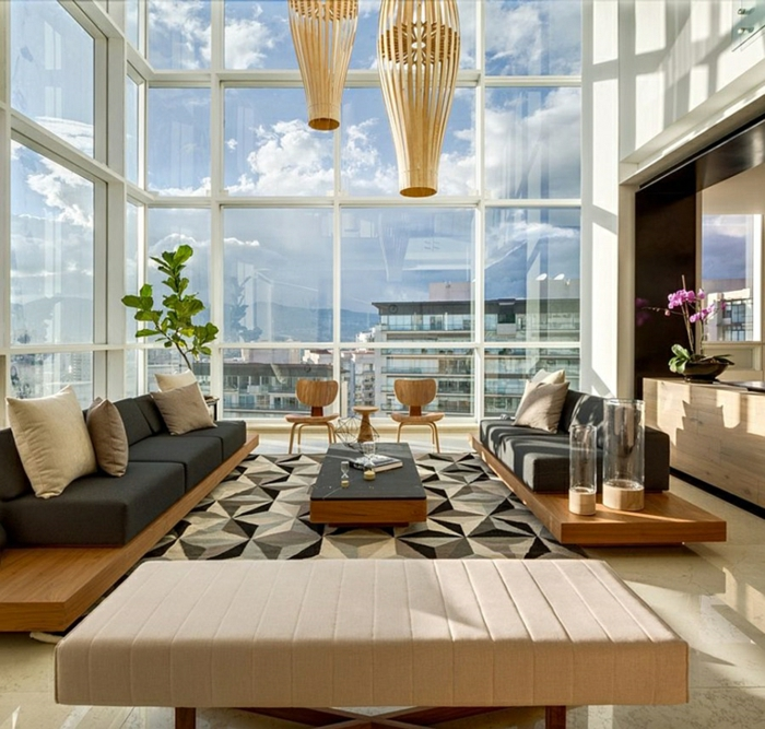 tall windows, black sofas, black wooden coffee table, beautiful living room ideas, white tiled floor