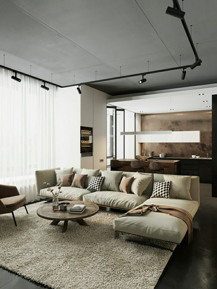 white corner sofa, small round wooden coffee table, contemporary living room, black floor with white carpet