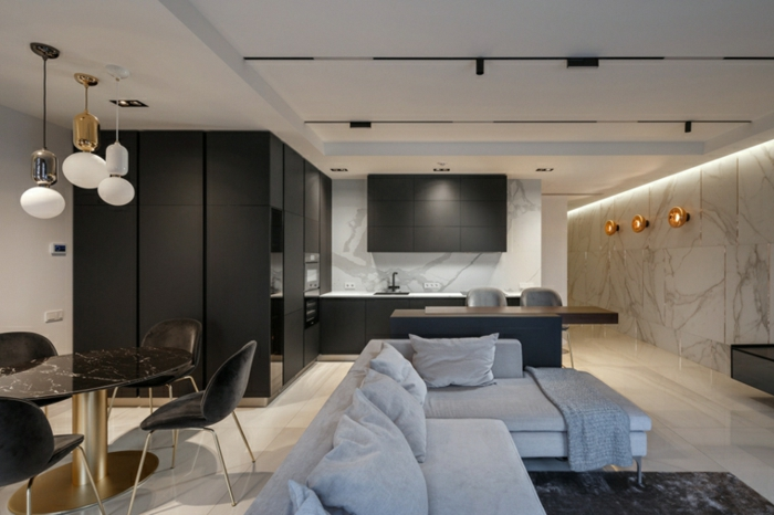 white corner sofa, marble accent walls, contemporary living room, open plan space with kitchen, living room and dining room
