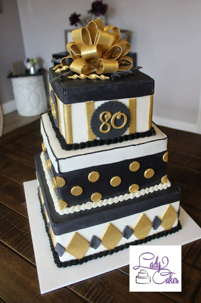 three tier square cake, decorated with black white and gold fondant, happy 80th birthday