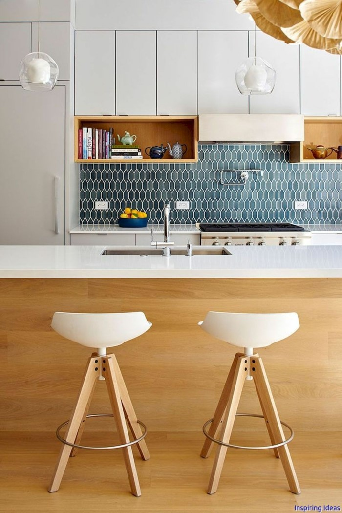 white cabinets with open shelving, mid century kitchen, blue tiles backsplash, wooden kitchen island, white countertops