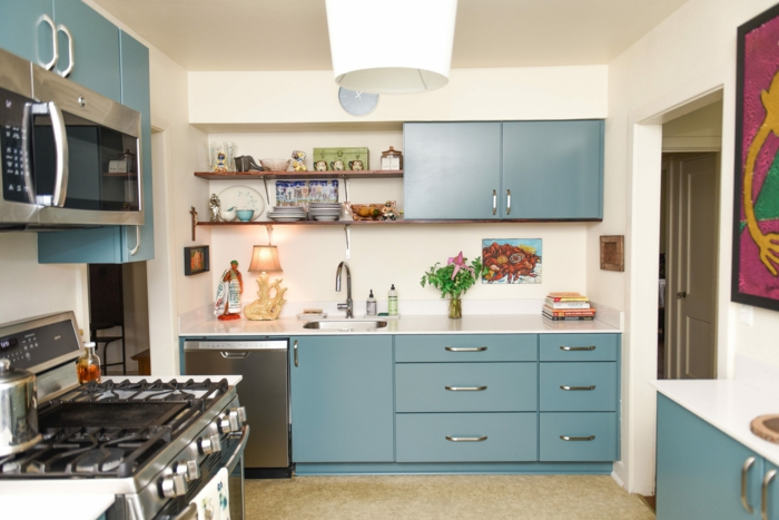 blue cabinets with white countertops, mid century kitchen, open shelving, white backsplash