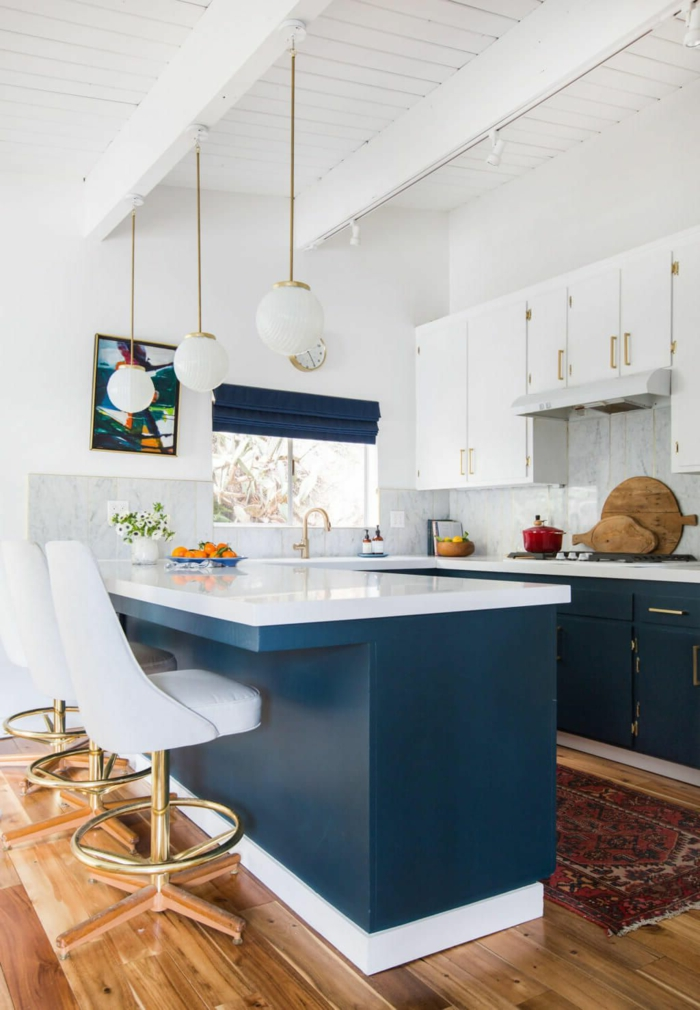 blue kitchen island and cabinets, white countertops, mid century kitchen, laminated wooden flooring