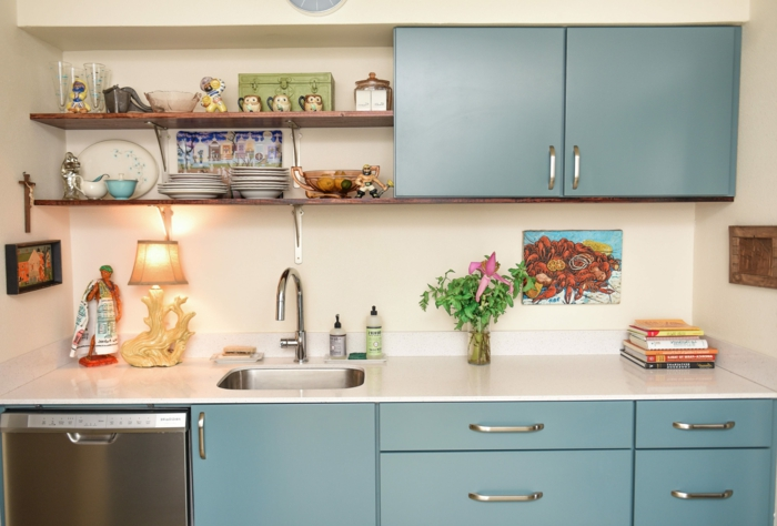 mid century modern cabinet, blue cabinets with white countertop, open shelving, white backsplash