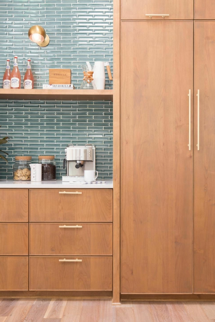 blue subway tiles backsplash, open shelving, mid century modern cabinet, wooden cabinets with white countertops
