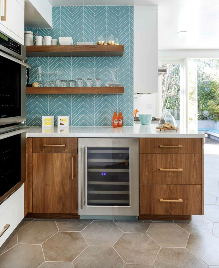 blue tiles backsplash, mid century modern cabinet, wooden cabinets with white countertops
