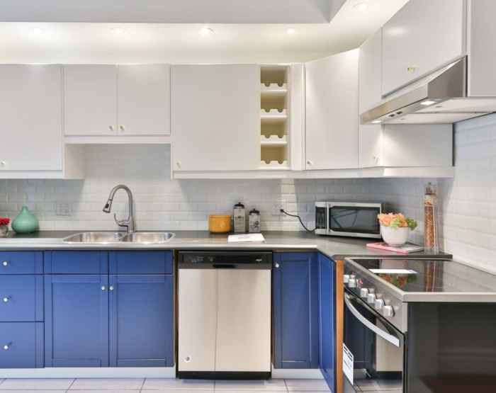 blue cabinets with grey countertop, mid century modern cabinet, white cabinets, white subway tiles backsplash
