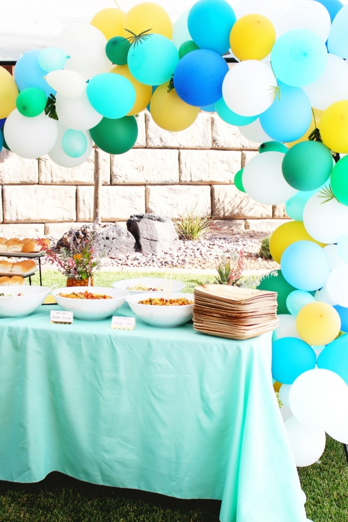 dessert table, blue white and gold balloon arch, 80th birthday ideas for dad, tropical themed party