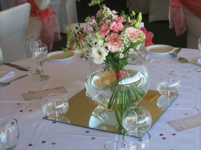 flower arrangement with pink and white flowers, placed in the middle of table, 80th birthday decorations
