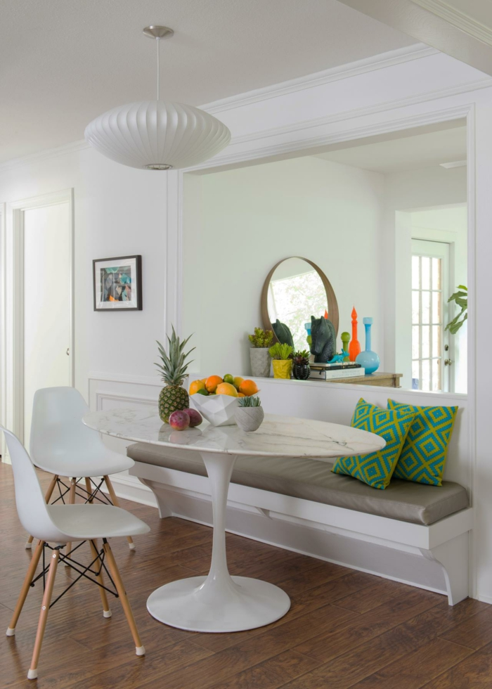 breakfast nook, bench with grey leather cushion, modern kitchen cabinets, laminated wooden flooring