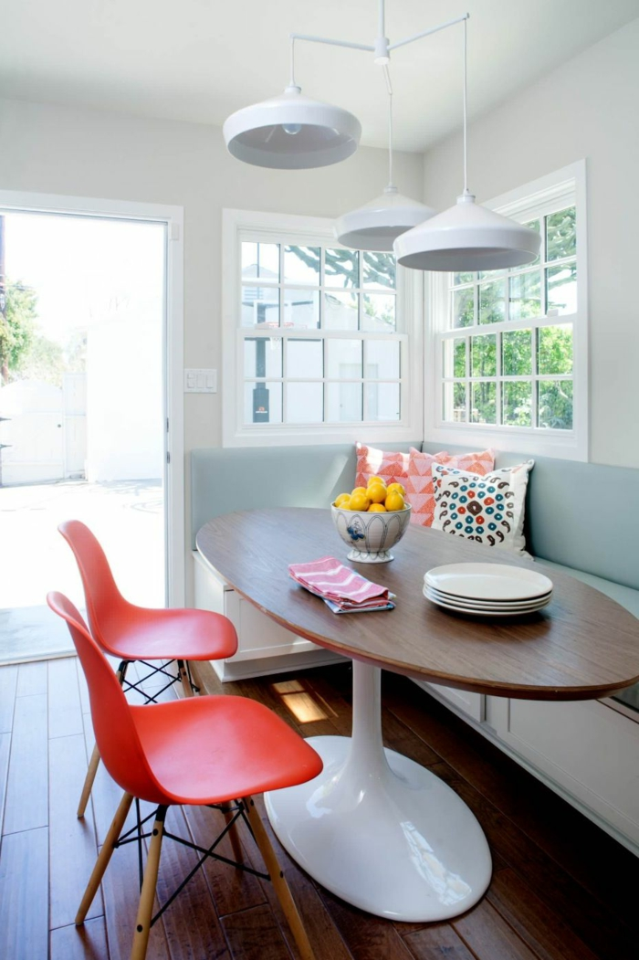 breakfast nook, mid century modern kitchen cabinets, sofa with light blue cushions, orange chairs