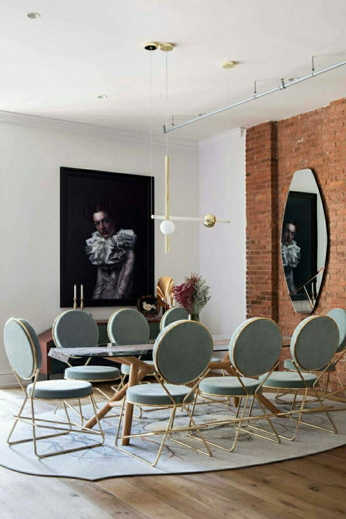 long glass dining table, eight grey chairs arranged around it, modern living room, brick accent wall