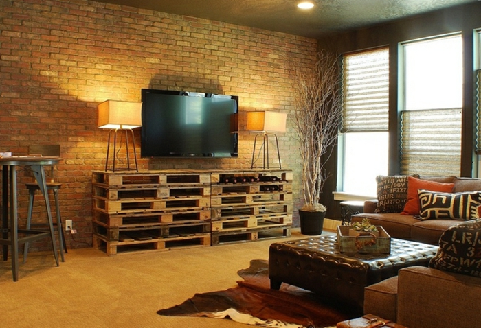 brick accent wall, pallet tv cabinet, how to decorate your living room, brown leather ottoman