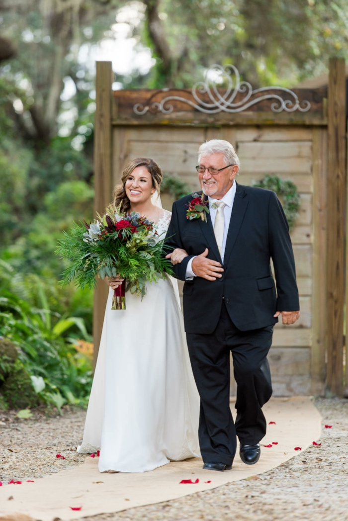 bride holding a large bouuet, being walked down the aisle by her father, wedding entrance songs, garden wedding