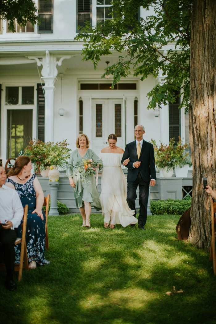 bride being walked down the aisle by her mother and father, wedding entrance songs, garden wedding