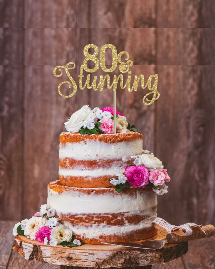 two tier cake with buttercream, 80th birthday ideas for mom, eighty and stunning cake topper, decorated with flowers