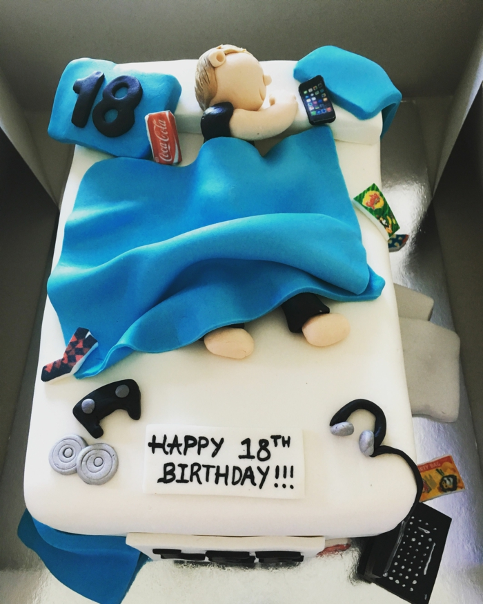 one tier cake, decorated with figurine of man in bed, birthday party themes, covered with white fondant