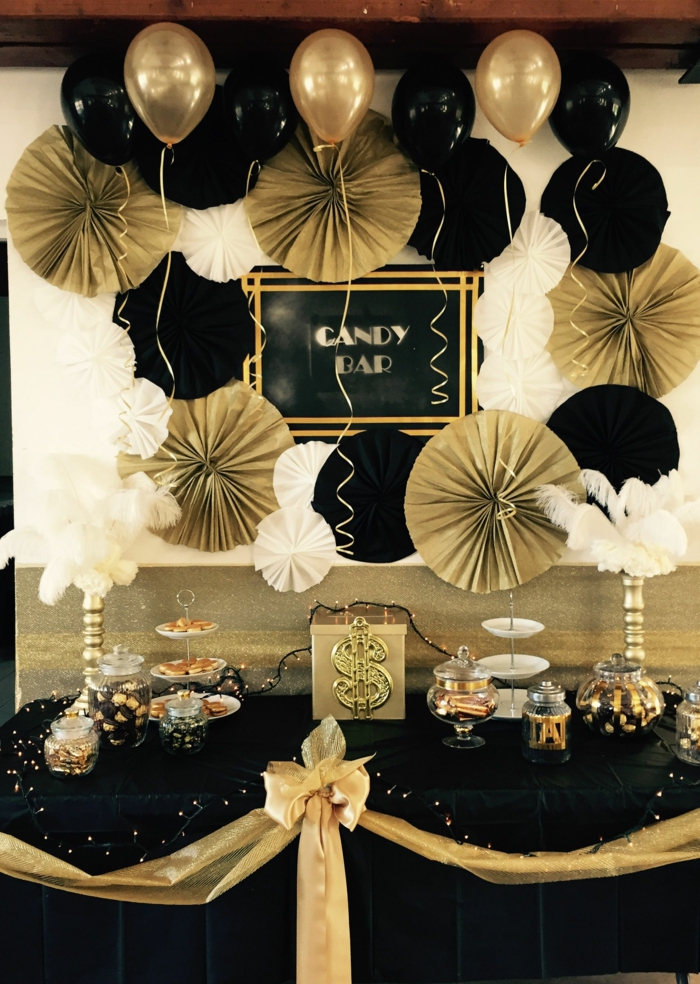 desserts table, black and gold decorations, 80th birthday ideas, black table cloth with gold ribbon