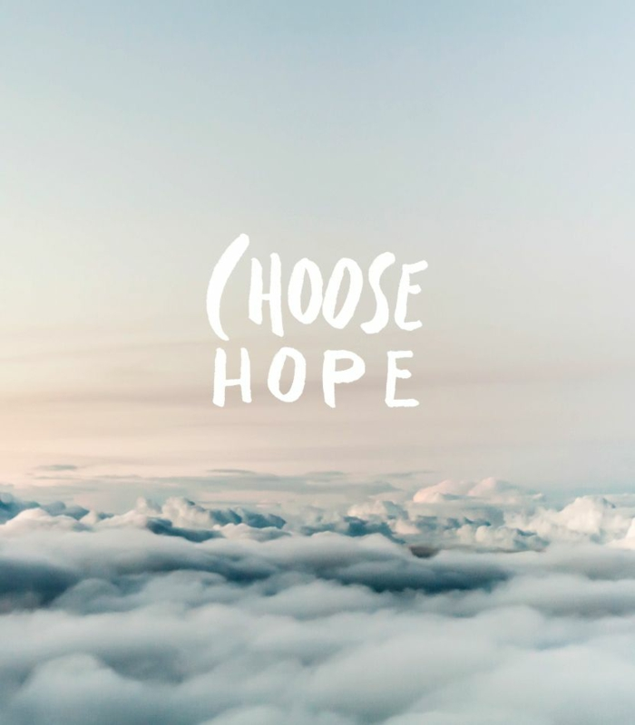choose hope, written with white letters, background photo from above the clouds
