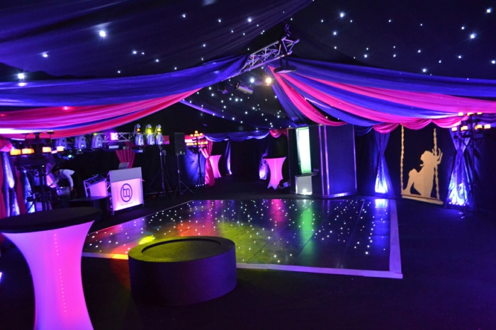 club party in neon colors, birthday party themes, dj table and dancefloor in the middle, tulle and fairy lights decor