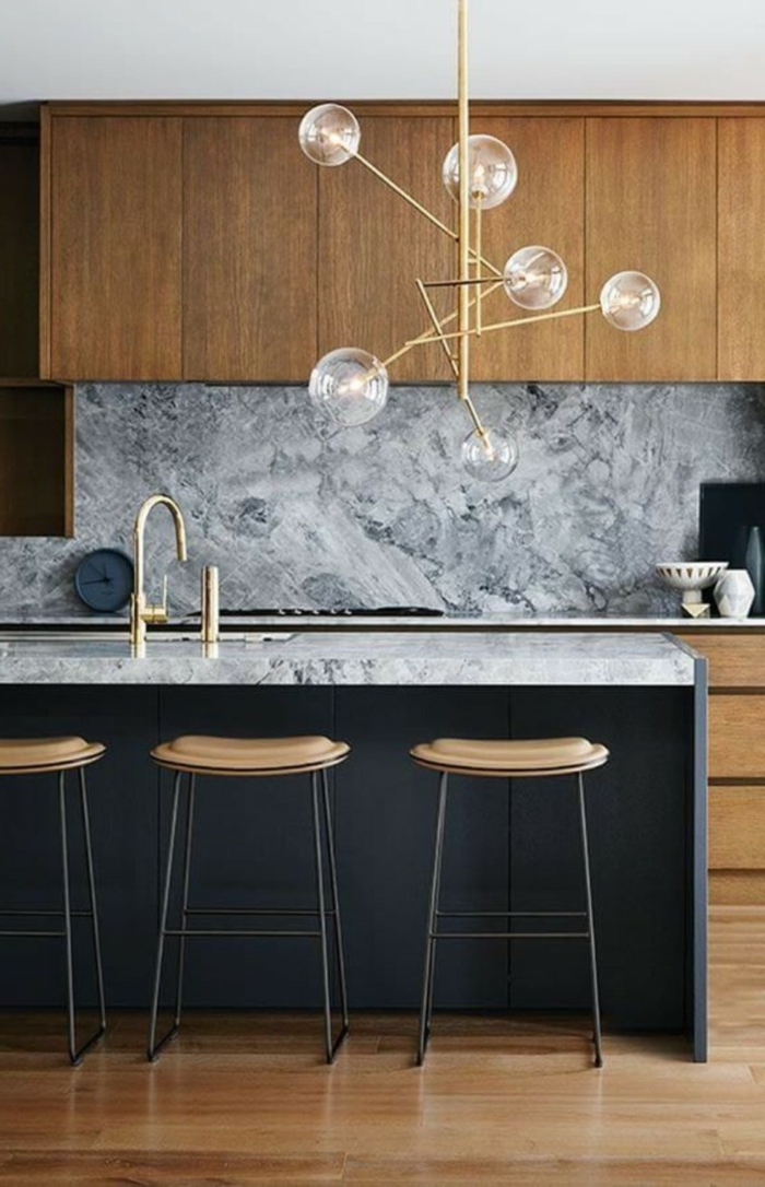 black kitchen island, wooden cabinets with marble countertops, mid century modern tile