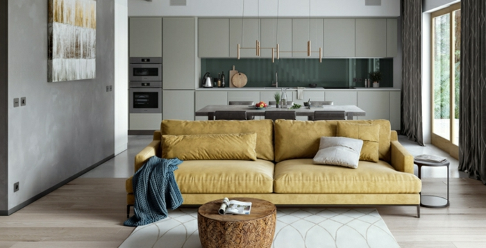 open plan space with kitchen and living room, modern living room decor, yellow sofa, small wooden coffee table