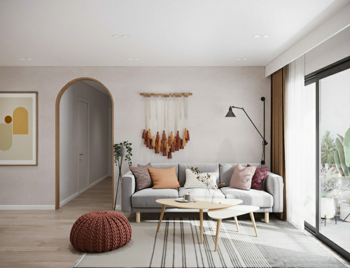 grey sofa with pink and orange throw pillows, modern living room ideas, brown knitted ottoman, wooden coffee table