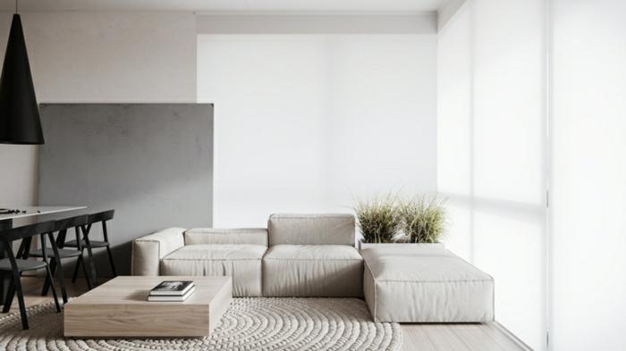 white corner sofa, white dining table with black chairs, modern living room decor, white carpet