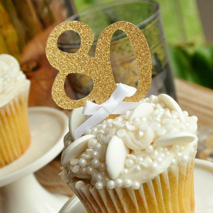 cupcake decorated with sugar pearls, 80th birthday party, gold glitter number eighty cupcake topper