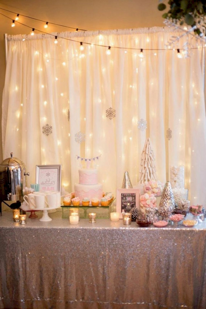 white tulle backdrop with fairy lights, 18th birthday gifts, desserts table with gold table cloth