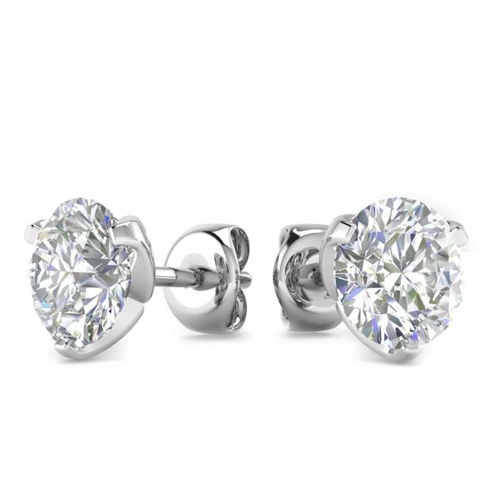 diamon stud earrings, placed on white surface, anniversary gifts for couples
