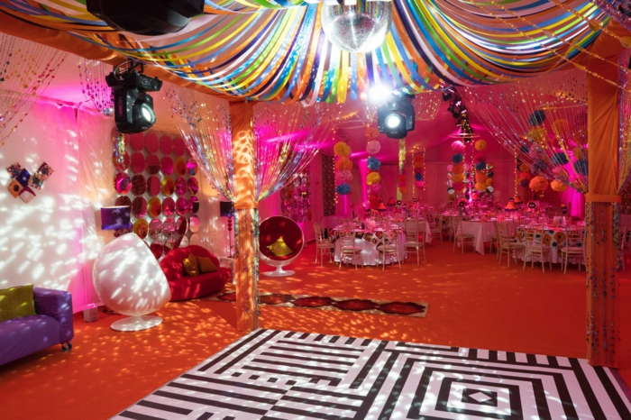 disco party with a disco ball, 18th birthday gift ideas, colorful paper flowers hanging from the ceiling