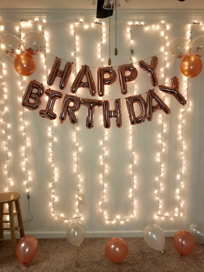 rose gold happy birthday balloons, hanging on white wall, 18th birthday gifts, fairy lights on the wall