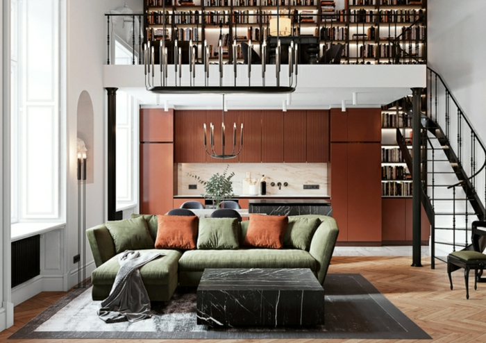 two storey open space apartment, kitchen living room and reading room, green corner sofa, large bookshelves