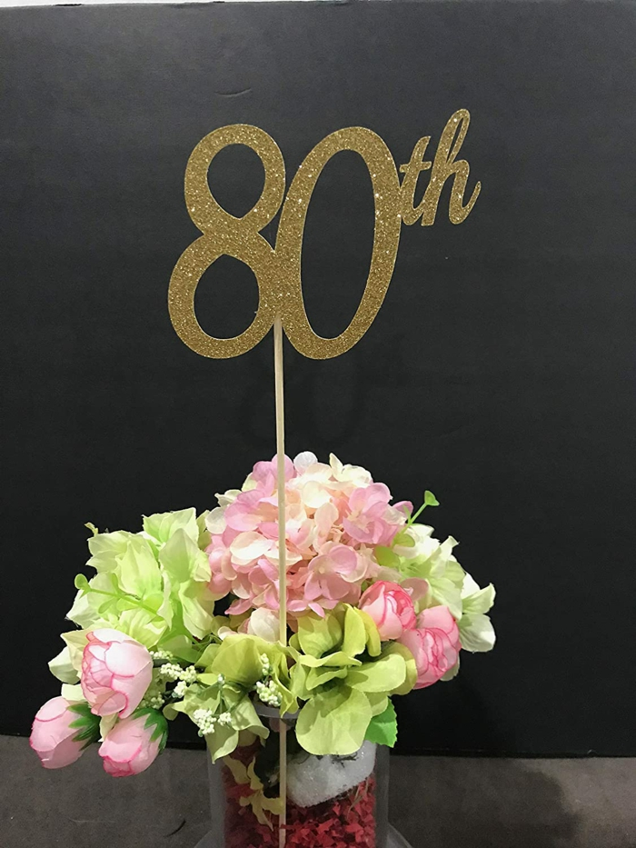 flower arrangement with pink and green flowers, 80th birthday decorations, gold glitter 80th sign in the middle